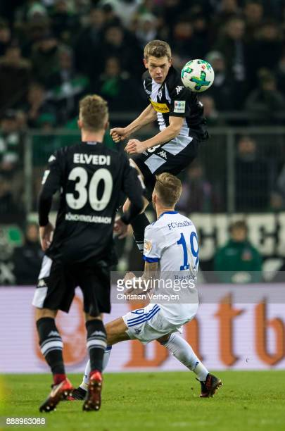 Matthias Ginter of Borussia Moenchengladbach and Guido Burgstaller of FC Schalke 04 battle for the ball during the Bundesliga match between Borussia...
