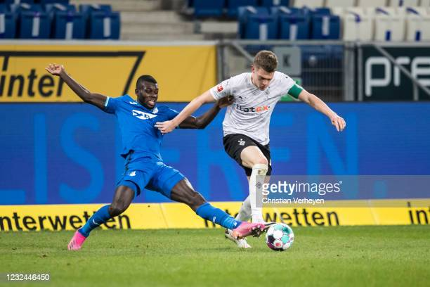 Matthias Ginter of Borussia Moenchengladbach and Ilhas Bebou of Hoffenheim battle for the ball during the Bundesliga match between TSG 1899...