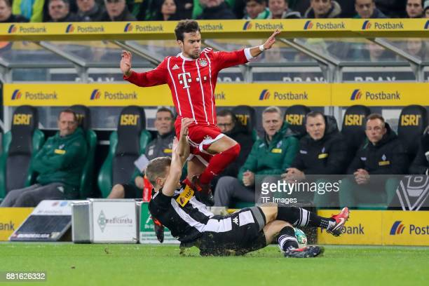 Matthias Ginter of Borussia Moenchengladbach and Juan Bernat of Bayern Muenchen battle for the ball during the Bundesliga match between Borussia...