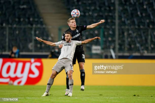 Matthias Ginter of Borussia Moenchengladbach and Junior Moraes of Shakhtar Donetsk battle for the ball during the Group B UEFA Champions League match...