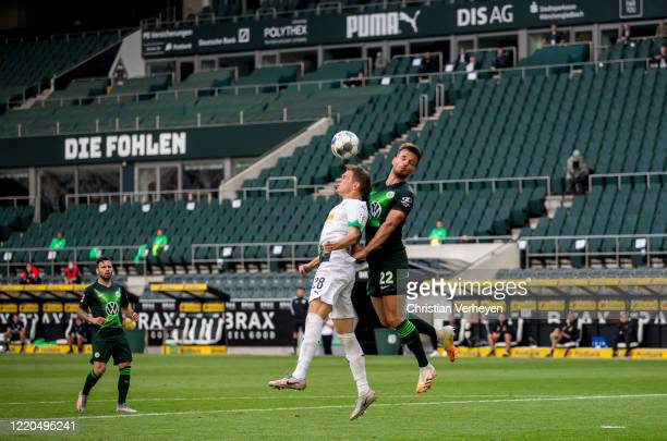Matthias Ginter of Borussia Moenchengladbach and Marin Pongracic of VfL Wolfsburg battle for the ball during the Bundesliga match between Borussia...