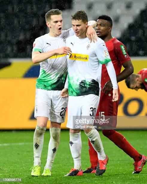 Matthias Ginter of Borussia Moenchengladbach and Nico Elvedi of Borussia Moenchengladbach celebrate after winning the Bundesliga match between...