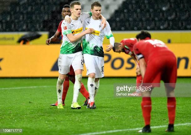 Matthias Ginter of Borussia Moenchengladbach and Nico Elvedi of Borussia Moenchengladbach celebrate during the Bundesliga match between Borussia...