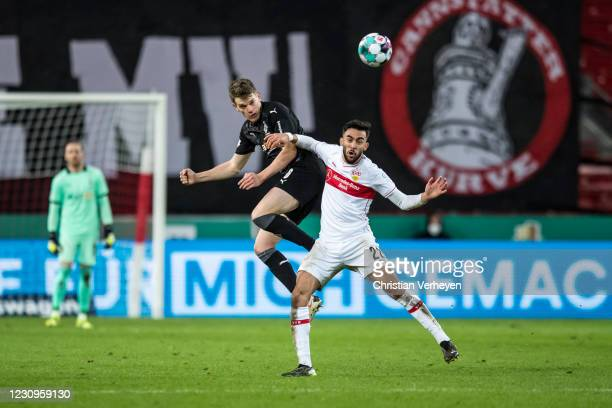 Matthias Ginter of Borussia Moenchengladbach and Nicolas Gonzalez of VfB Stuttgart battle for the ball during the DFB Cup match between VfB Stuttgart...