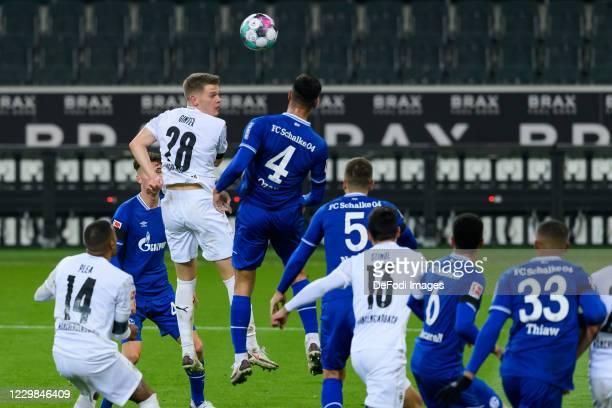 Matthias Ginter of Borussia Moenchengladbach and Ozan Kabak of FC Schalke 04 battle for the ball during the Bundesliga match between Borussia...