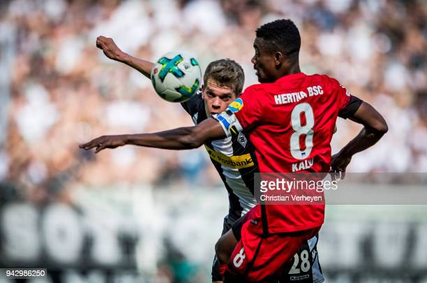 Matthias Ginter of Borussia Moenchengladbach and Salomon Kalou of Hertha BSC battle for the ball during the Bundesliga match between Borussia...