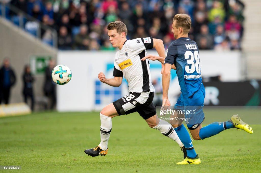 Matthias Ginter of Borussia Moenchengladbach and Stefan Posch of 1899 Hoffenheim battle for the ball during the Bundesliga match between TSG1899 Hoffenheim and Borussia Moenchengladbach at Wirsol Rhein-Neckar-Arena on October 28, 2017 in Sinsheim, Germany.