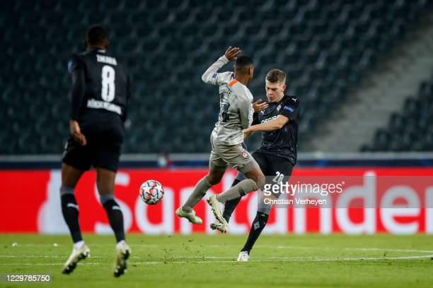 Matthias Ginter of Borussia Moenchengladbach and Tete of Shakhtar Donezk battle for the ball during the Group B UEFA Champions League match between...