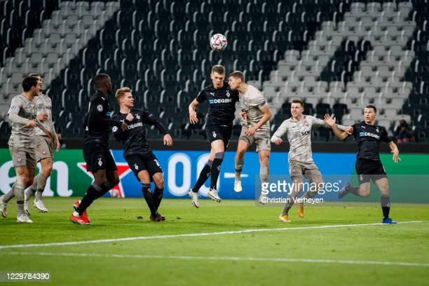 Matthias Ginter of Borussia Moenchengladbach and Valeriy Bondar of Shakhtar Donetsk battle for the ball during the Group B UEFA Champions League...