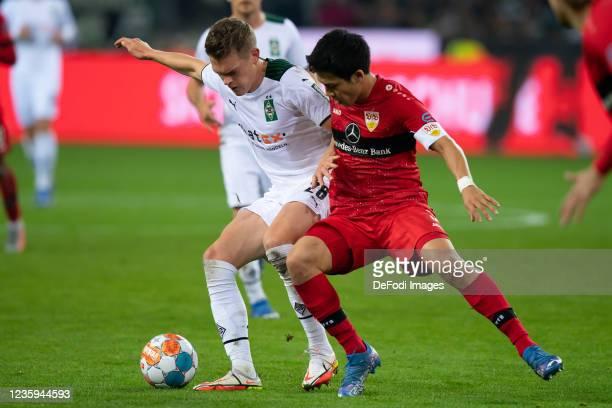 Matthias Ginter of Borussia Moenchengladbach and Wataru Endo of VfB Stuttgart battle for the ball during the Bundesliga match between Borussia...