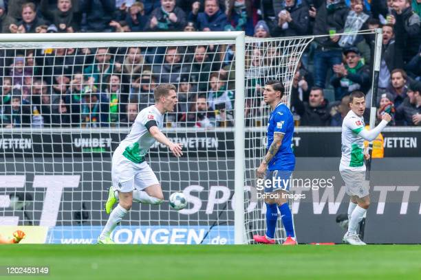 Matthias Ginter of Borussia Moenchengladbach celebrates after scoring his team's first goal during the Bundesliga match between Borussia...
