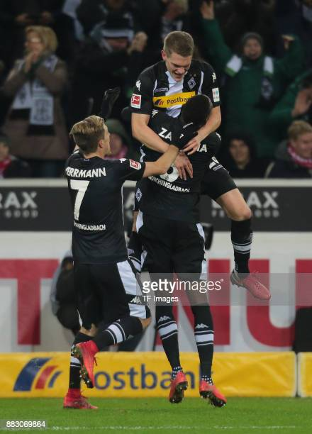 Matthias Ginter of Borussia Moenchengladbach celebrates after scoring his team`s second goal with Patrick Herrmann of Borussia Moenchengladbach and...