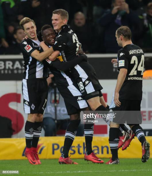 Matthias Ginter of Borussia Moenchengladbach celebrates after scoring his team`s second goal with Patrick Herrmann of Borussia Moenchengladbach Denis...