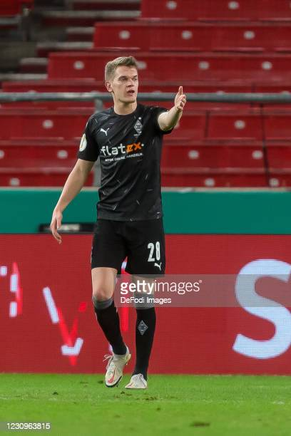 Matthias Ginter of Borussia Moenchengladbach gestures during the DFB Cup Round of Sixteen match between VfB Stuttgart and Borussia Mönchengladbach at...