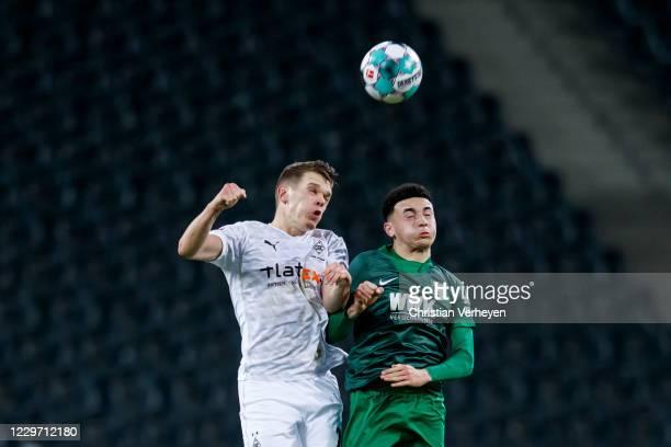 Matthias Ginter of Borussia Moenchengladbach heads the ball during the Bundesliga match between Borussia Moenchengladbach and FC Augsburg at...