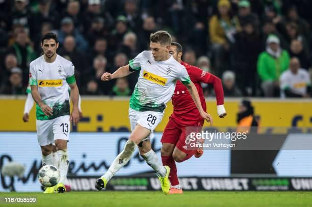 Matthias Ginter of Borussia Moenchengladbach in action during the Bundesliga match between Borussia Moenchengladbach and FC Bayern Muenchen at...