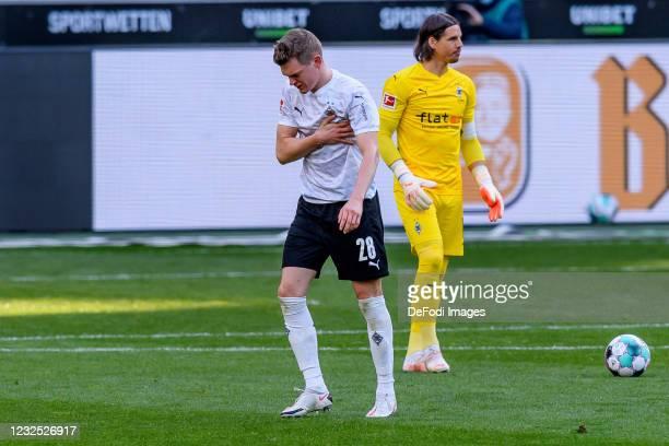 Matthias Ginter of Borussia Moenchengladbach injured during the Bundesliga match between Borussia Moenchengladbach and DSC Arminia Bielefeld at...