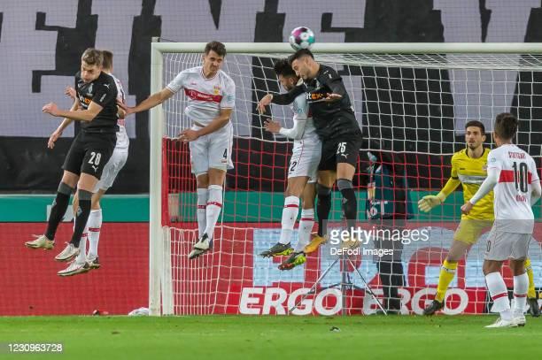Matthias Ginter of Borussia Moenchengladbach, Marc Oliver Kempf of VfB Stuttgart, Nicolas Gonzalez of VfB Stuttgart and Ramy Bensebaini of Borussia...