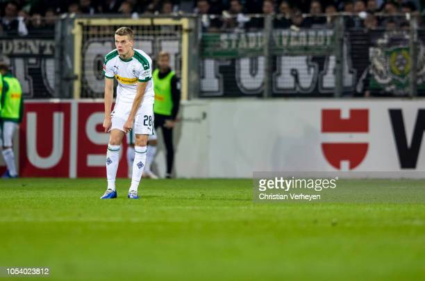 Matthias Ginter of Borussia Moenchengladbach reacts after Freiburgs second goal during the Bundesliga match between SportClub Freiburg and Borussia...