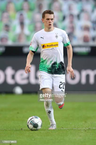 Matthias Ginter of Borussia Moenchengladbach runs with the ball during the Bundesliga match between Borussia Moenchengladbach and VfL Wolfsburg at...