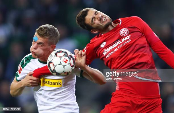 Matthias Ginter of Borussia Monchengladbach and Stefan Bell of FSV Mainz jump for a header during the Bundesliga match between Borussia...