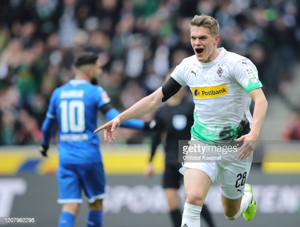 Matthias Ginter of Borussia Monchengladbach celebrates after scoring his sides first goal during the Bundesliga match between Borussia...