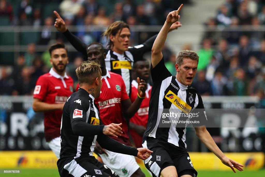 Matthias Ginter of Borussia Monchengladbach celebrates scoring his teams first goal of the game during the Bundesliga match between Borussia Moenchengladbach and Hannover 96 at Borussia-Park on September 30, 2017 in Moenchengladbach, Germany.
