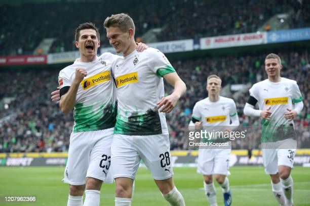 Matthias Ginter of Borussia Monchengladbach celebrates with teammate Jonas Hofmann after scoring his sides first goal during the Bundesliga match...