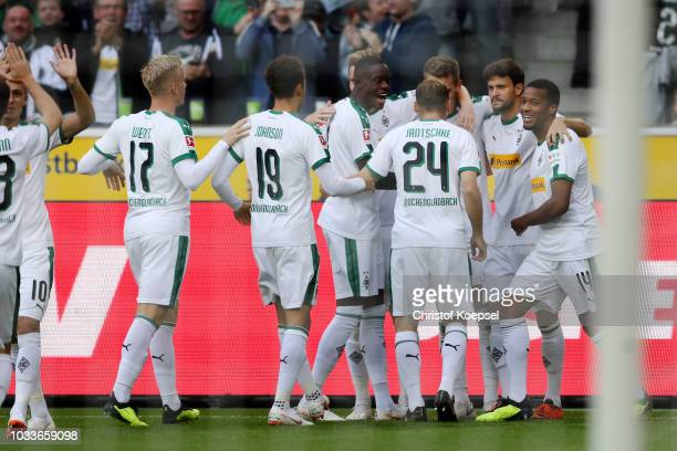 Matthias Ginter of Borussia Monchengladbach celebrates with teammates after scoring his team's first goal during the Bundesliga match between...