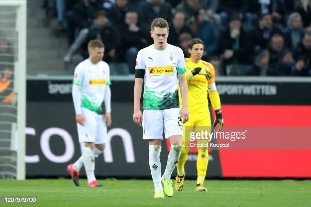Matthias Ginter of Borussia Monchengladbach looks dejected after conceding a goal during the Bundesliga match between Borussia Moenchengladbach and...