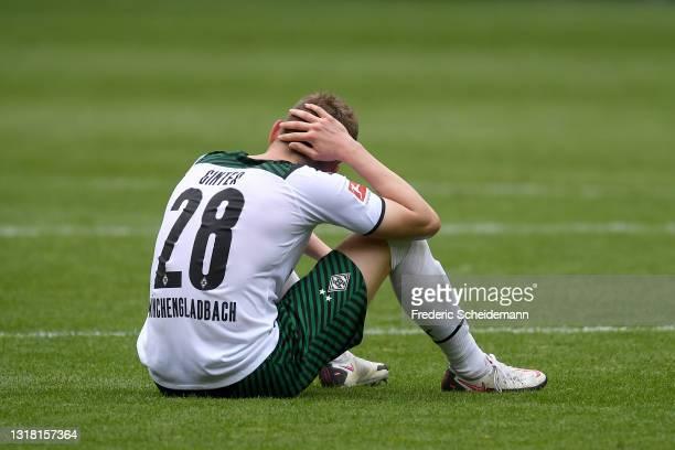 Matthias Ginter of Borussia Monchengladbach looks dejected following the Bundesliga match between Borussia Moenchengladbach and VfB Stuttgart at...