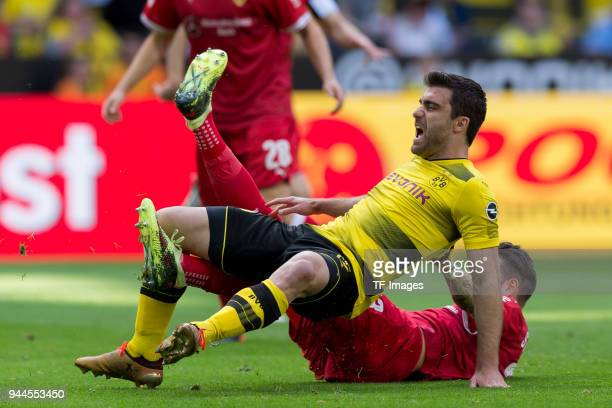 Matthias Ginter of Dortmund and Daniel Ginczek of Stuttgart battle for the ball during the Bundesliga match between Borussia Dortmund and VfB...