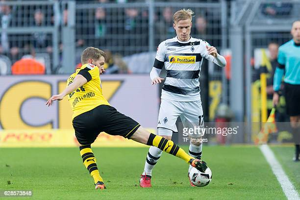 Matthias Ginter of Dortmund and Oscar Wendt of Moenchengladbach battle for the ball during the Bundesliga match between Borussia Dortmund and...
