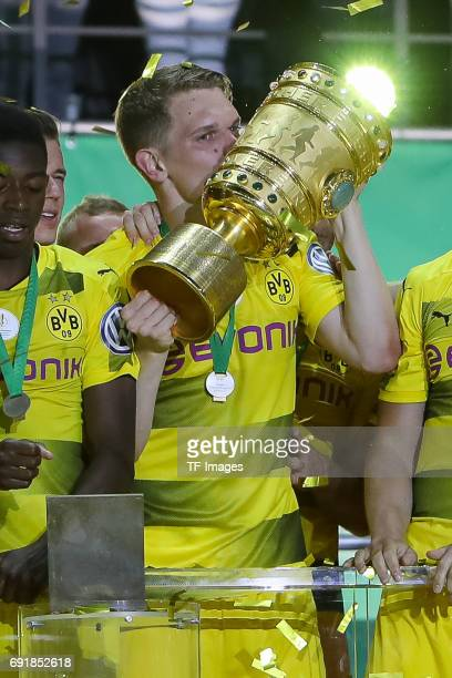 Matthias Ginter of Dortmund celebrates with the trophy after winning the DFB Cup final match between Eintracht Frankfurt and Borussia Dortmund at...