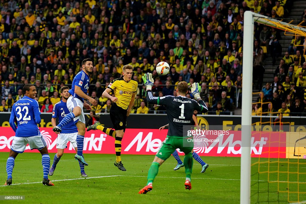 Matthias Ginter of Dortmund scores the second goal against Ralf Faehrmann of Schalke during the Bundesliga match between Borussia Dortmund and FC Schalke 04 at Signal Iduna Park on November 8, 2015 in Dortmund, Germany.