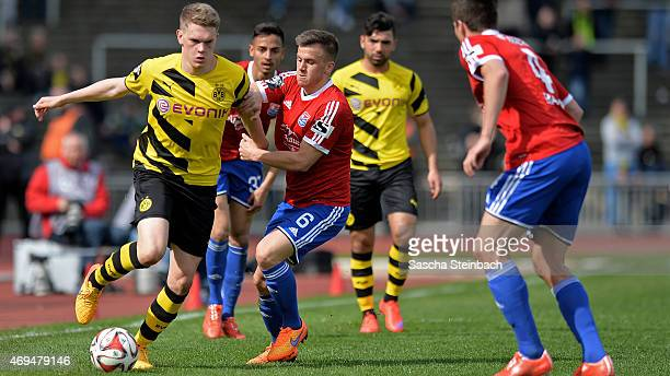 Matthias Ginter of Dortmund vies with Simon Kranitz of Unterhaching during the 3 Liga match between Borussia Dortmund II and SpVgg Unterhaching at...