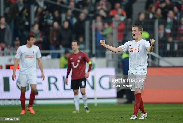Matthias Ginter of Freiburg celebrates at the end as his team remains in the first Bundesliga after the Bundesliga match between Hannover 96 and SC...