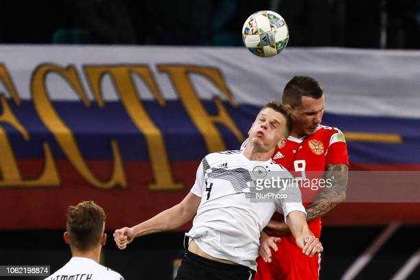 Matthias Ginter of Germany and Anton Zabolotny of Russia vie for a header during the international friendly match between Germany and Russia on...