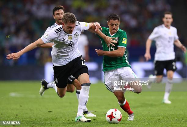 Matthias Ginter of Germany and Javier Hernandez of Mexico compete for the ball during the FIFA Confederations Cup Russia 2017 SemiFinal between...