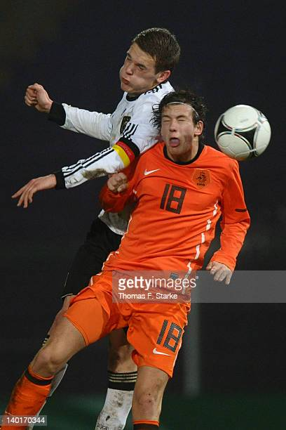 Matthias Ginter of Germany and Romano van der Stoep of Netherlands head for the ball during the U18 international friendly match between Germany and...