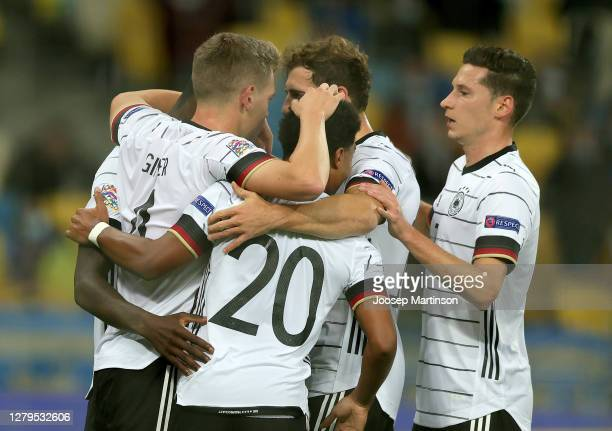 Matthias Ginter of Germany celebrates with teammates after scoring his team's first goal during the UEFA Nations League group stage match between...