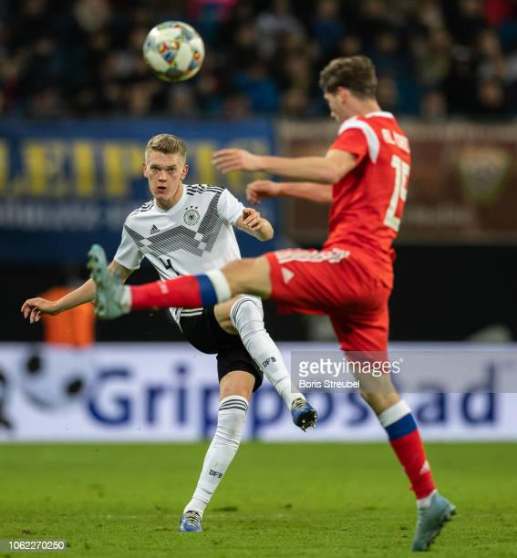 Matthias Ginter of Germany is challenged by Aleksey Miranchuk of Russia during the International Friendly match between Germany and Russia at Red...