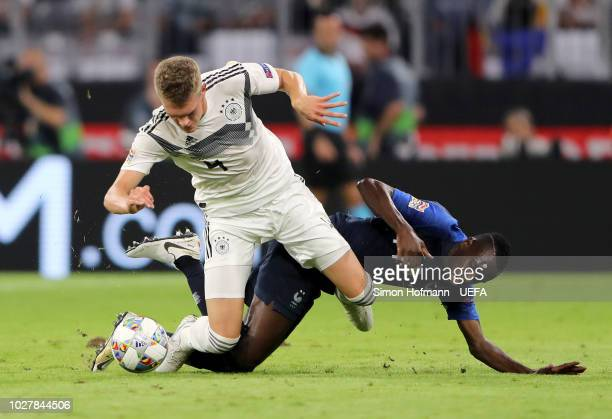 Matthias Ginter of Germany is challenged by Blaise Matuidi of France during the UEFA Nations League Group A match between Germany and France at...