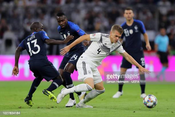 Matthias Ginter of Germany is challenged by N'Golo Kante of France and Blaise Matuidi of France during the UEFA Nations League Group A match between...