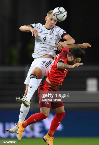 Matthias Ginter of Germany jumps for a header with Renato Steffen of Switzerland during the UEFA Nations League group stage match between Switzerland...