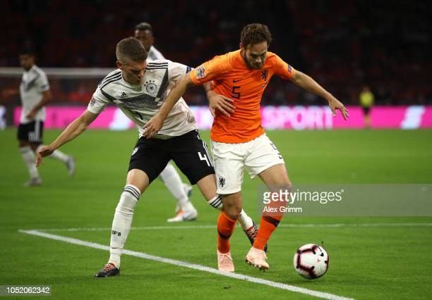 Matthias Ginter of Germany tackles Daley Blind of the Netherlands during the UEFA Nations League A group one match between Netherlands and Germany at...