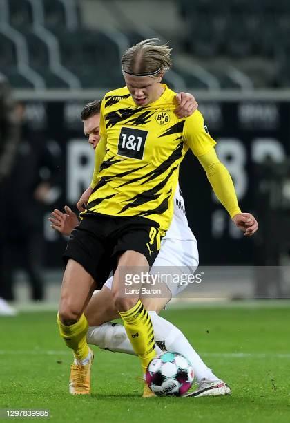 Matthias Ginter of Gladbach challenges Erling Håland of Dortmund during the Bundesliga match between Borussia Moenchengladbach and Borussia Dortmund...