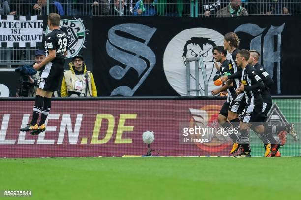 Matthias Ginter of Moenchengladbach celebrates after scoring his team`s first goal during the Bundesliga match between Borussia Moenchengladbach and...