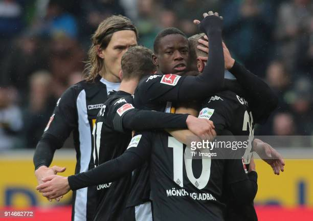 Matthias Ginter of Moenchengladbach celebrates after scoring his team`s first goal with Thorgan Hazard and Denis Zakaria of Moenchengladbach during...