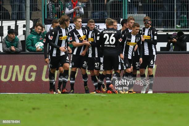 Matthias Ginter of Moenchengladbach celebrates with his teammates after scoring his team's first goal to make it 10 during the Bundesliga match...